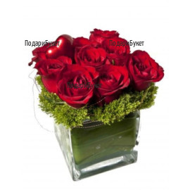 Romantic arrangement with red roses in glass cube