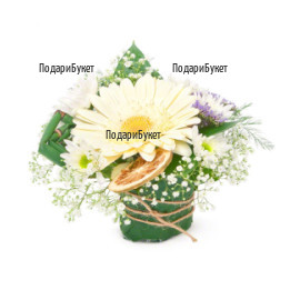 Arrangement with gerbera and greenery