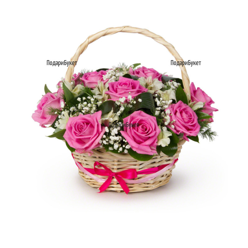 A basket with pink roses and greenery